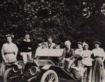 "4 x 3"" L to R: Victoria, Frank Common, Lloyd, not known, Evelyn (at wheel), Mother, Stella, Agnes, Rebecca, Murray (on running board) Taken `Sandy Cove`, Lake Simcoe, 1910, around 1907 Hupmobile"